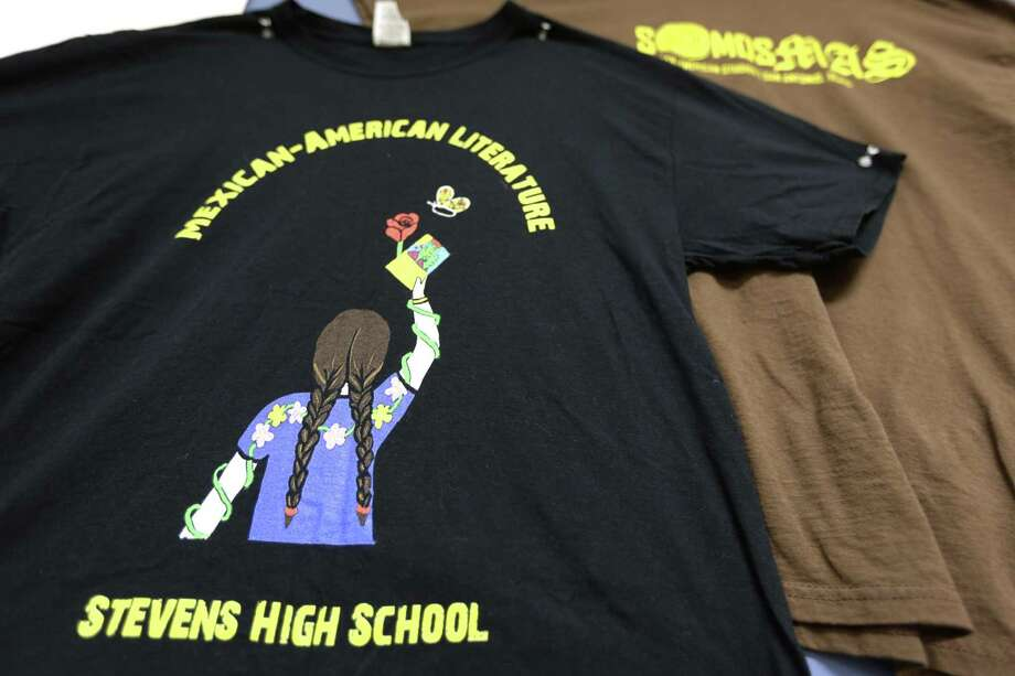 A t-shirt designed for Stevens High School teacher Andres Lopez's Mexican American literature elective class hangs on Lopez's classroom wall June 6, 2018. Photo: William Luther / (c)2015 William Luther