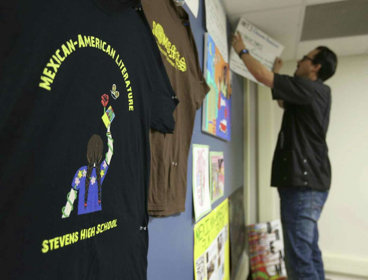 Stevens High School teacher Andres Lopez removes project created by his Mexican American literature elective class students off his classroom walls June 6, 2018.