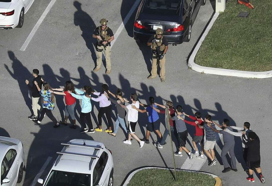 PARKLAND, FL - FEBRUARY 14: People are brought out of the Marjory Stoneman Douglas High School after a shooting at the school that reportedly killed and injured multiple people on February 14, 2018 in Parkland, Florida. Numerous law enforcement officials continue to investigate the scene. (Photo by Joe Raedle/Getty Images) Photo: Joe Raedle, Staff / Getty Images / 2018 Getty Images