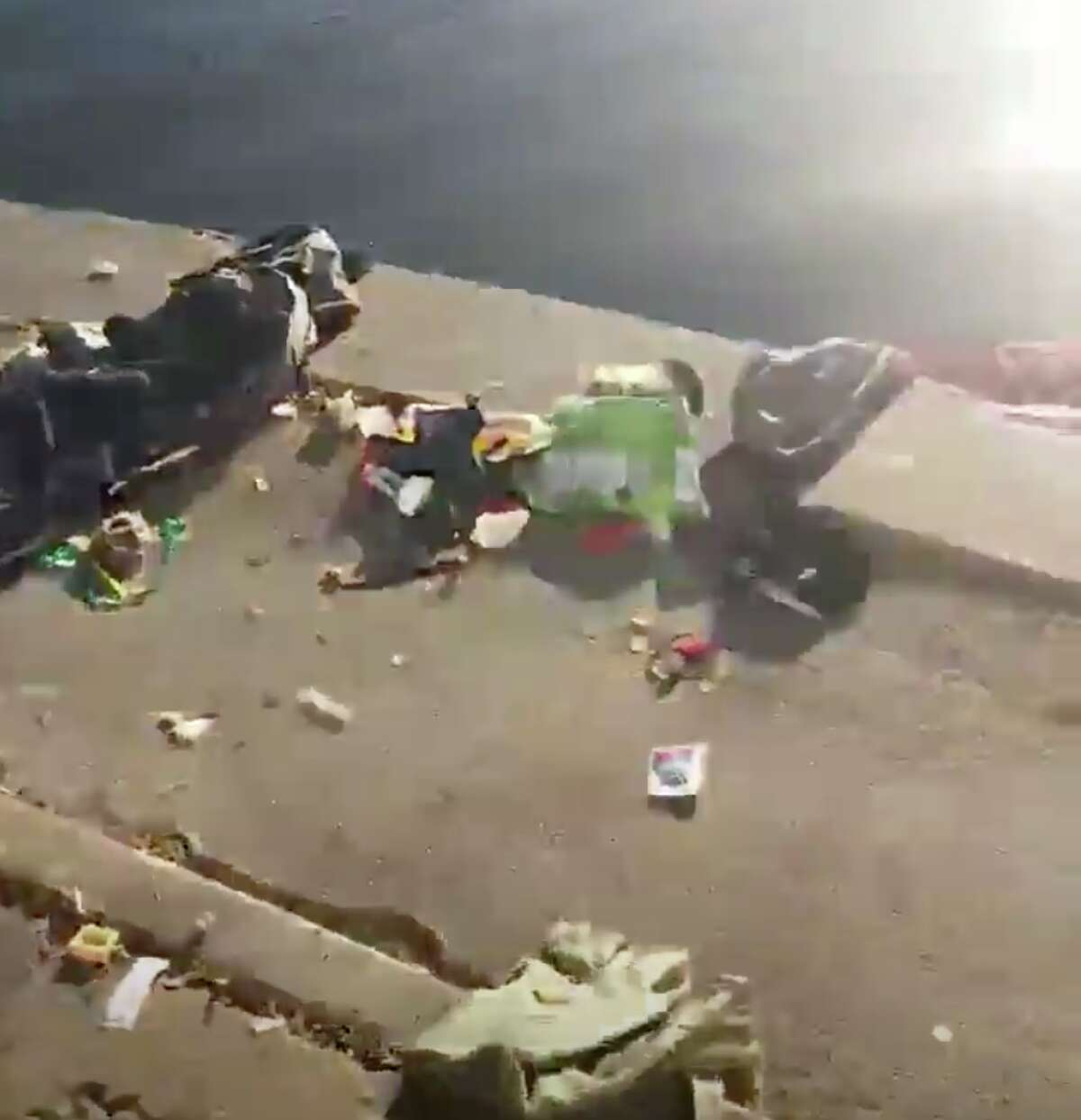 A video shows a jogger dismantling a homeless man's encampment at Lake Merritt and some of the witnesses say he threw some of the items into the lake.