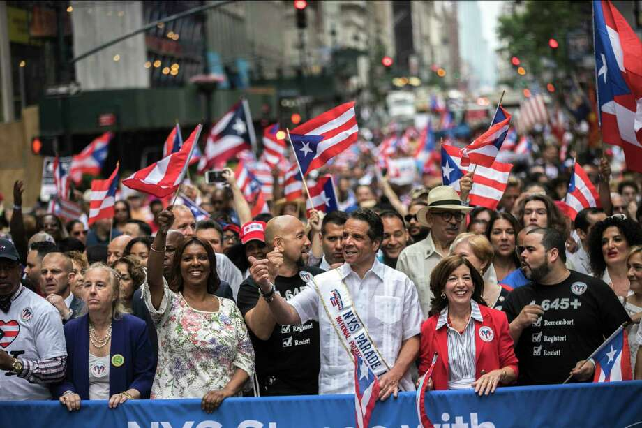 New York Gov. Andrew Cuomo, center, participates in the 2018 National Puerto Rican Day Parade in New York, June 10, 2018. (Jeenah Moon/The New York Times) Photo: JEENAH MOON / NYTNS
