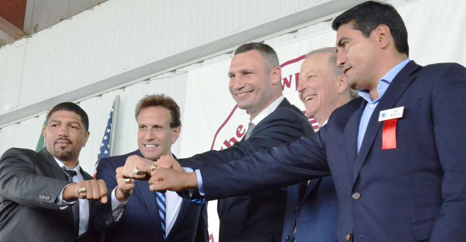 From left, International Boxing Hall of Fame Class of 2018 inductees Ronald Wright, Steve Albert, Vitali Klitschko, Jim Gray, and Erik Morales present their Hall of Fame rings to the crowd gathered in Canastota, New York on Sunday, June 10, 2018. (John Brewer/Oneida Daily Dispatch via AP) Photo: John Brewer/Associated Press