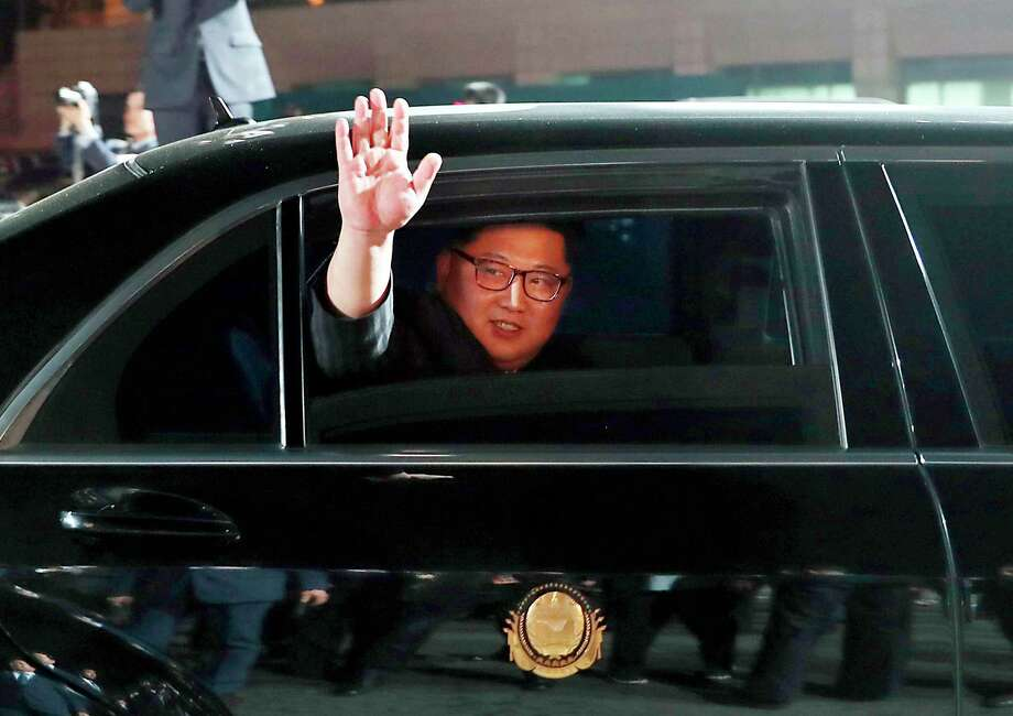 FILE - In this April 27, 2018, file photo, North Korean leader Kim Jong Un waves from a car as he returns to North Korea after the meeting with South Korean President Moon Jae-in at the border village of Panmunjom in the Demilitarized Zone. Kim is on a rare trip abroad as he leaves the all-encompassing bubble of his locked-down stronghold of Pyongyang and steps off a jet onto Singaporean soil for his planned sit-down witU.S. President Donald Trump on Tuesday, June 12, 2018. (Korea Summit Press Pool via AP, File) / Korea Summit Press Pool
