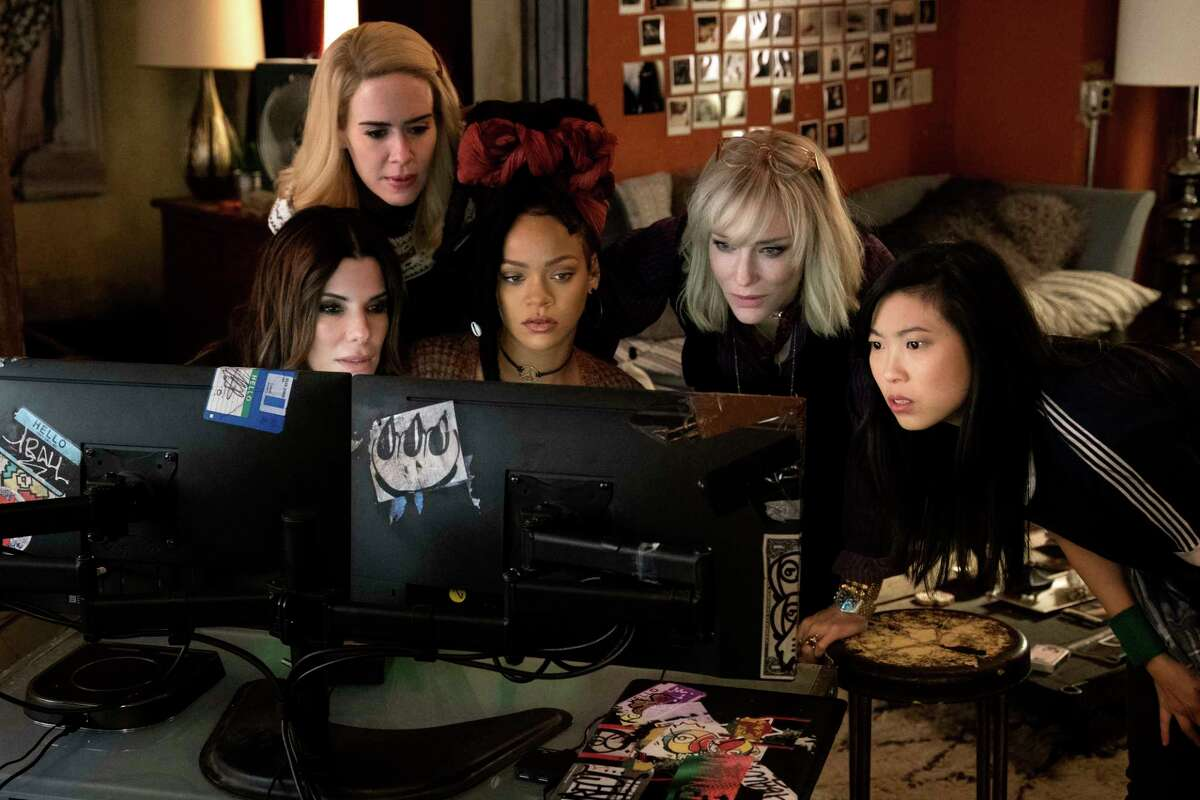 This image released by Warner Bros. shows, from foreground left, Sandra Bullock Sarah Paulson, Rihanna, Cate Blanchett and Awkwafina in a scene from