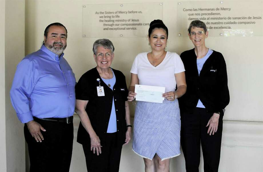 "Zulema S. Valle, executive assistant for Sanchez Management Corporation, presents a $50,000 check on behalf of the A.R. ""Tony"" and Maria J. Sanchez Foundation to Sister Maria Luisa Vera, president of Mercy Ministries of Laredo and Sister Rosemary Welsh, director of outreach for the health clinic. Also pictured is Goyo López, director of development. Photo: Courtesy Photo"