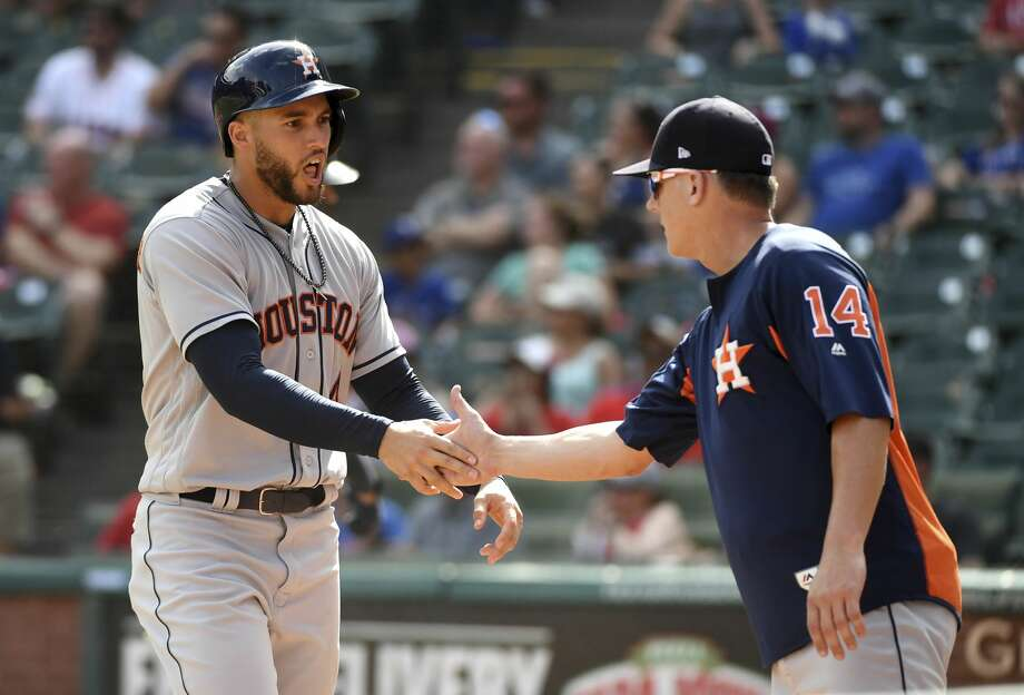 Houston Astros' George Springer, left, is congratulated by Houston Astros manager AJ Hinch, right,  after scoring the winning run on a balk by Texas Rangers relief pitcher Keone Kela during the ninth inning of a baseball game, Sunday, June 10, 2018, in Arlington, Texas. Houston won 8-7. (AP Photo/Jeffrey McWhorter) Photo: Jeffrey McWhorter/Associated Press