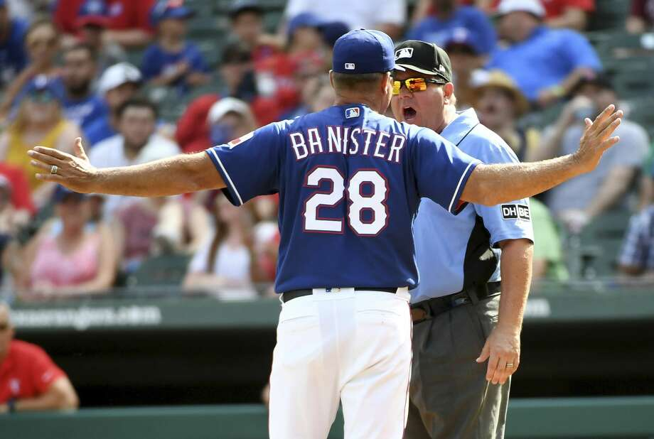 Texas Rangers manager Jeff Banister argues with third base umpire Sam Holbrook after Rangers relief pitcher Keone Kela was called for a balk which gave the Houston Astros the winning run during the ninth inning of a baseball game, Sunday, June 10, 2018, in Arlington, Texas. Banister was ejected, and Houston won 8-7. (AP Photo/Jeffrey McWhorter) Photo: Jeffrey McWhorter/Associated Press