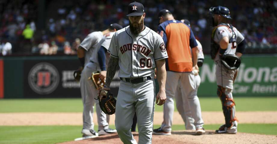 Houston Astros starting pitcher Dallas Keuchel (60) walks to the dugout after being pulled during the fifth inning of a baseball game against the Texas Rangers, Sunday, June 10, 2018, in Arlington, Texas. Houston won 8-7. (AP Photo/Jeffrey McWhorter) Photo: Jeffrey McWhorter/Associated Press