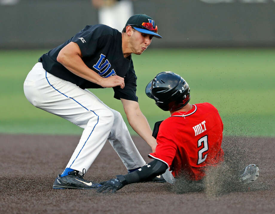 Duke's Zack Kone (2) tags out Texas Tech's Gabe Holt (2) as he slides into second base during an NCAA college baseball tournament super regional game Sunday, June 10, 2018, in Lubbock, Texas. (Brad Tollefson/Lubbock Avalanche-Journal via AP)