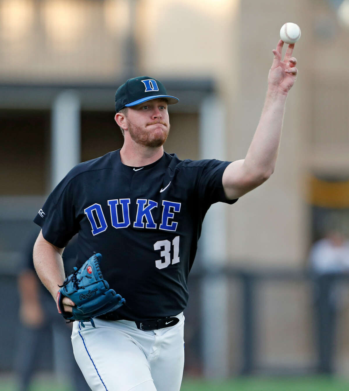 Duke's Graeme Stinson (31) throws the ball to first base during an NCAA college baseball tournament super regional game against Texas Tech, Sunday, June 10, 2018, in Lubbock, Texas. (Brad Tollefson/Lubbock Avalanche-Journal via AP)