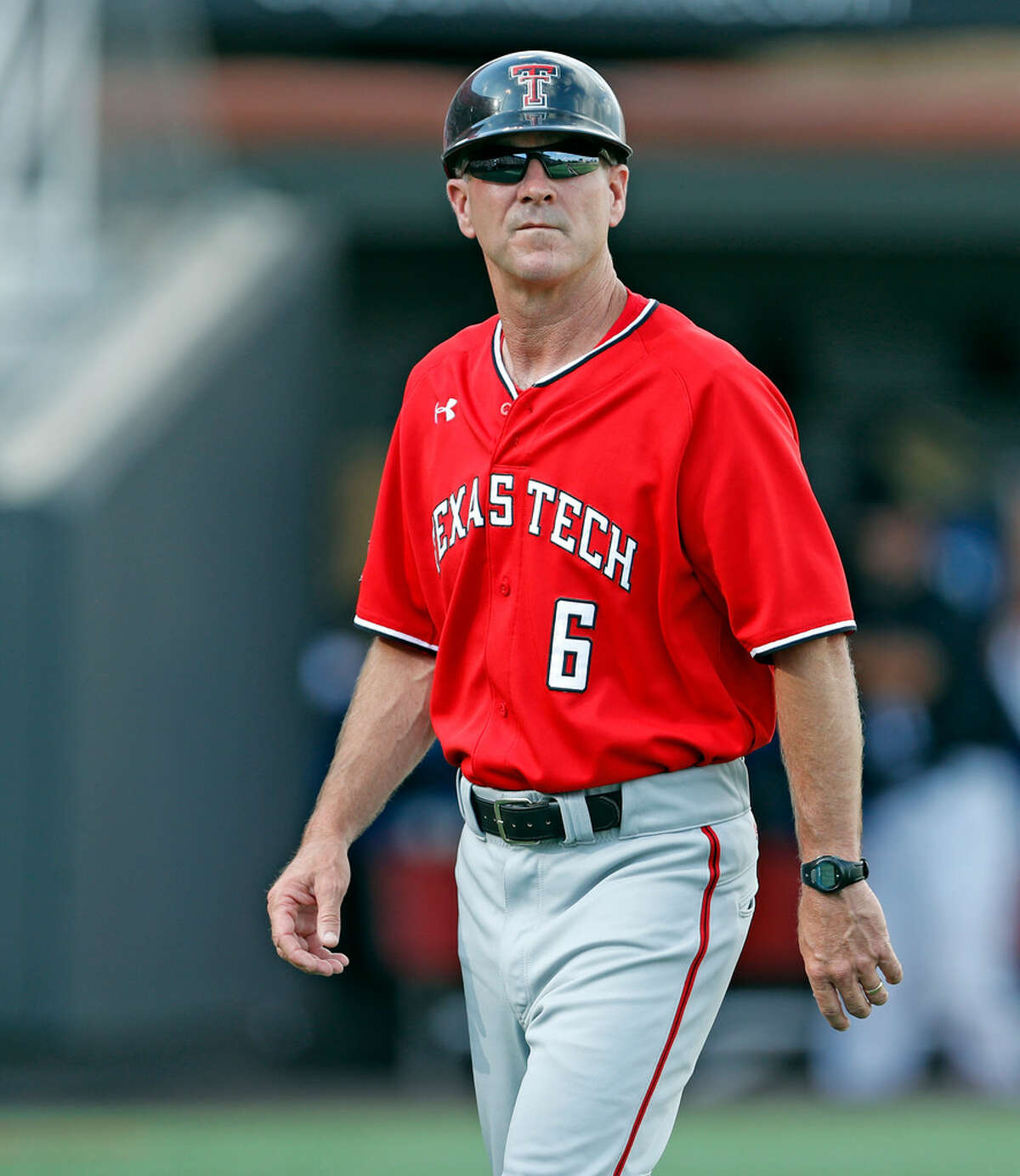 Texas Tech coach Tim Tadlock walks back to the dugout during an NCAA college baseball tournament super regional game against Duke, Sunday, June 10, 2018, in Lubbock, Texas. (Brad Tollefson/Lubbock Avalanche-Journal via AP)