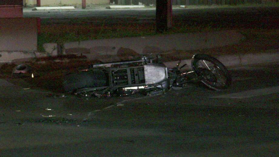 A motorcyclist was hospitalized after colliding into a car on Northwest 24th and West Poplar streets on June 11, 2018. Photo: Ken Branca