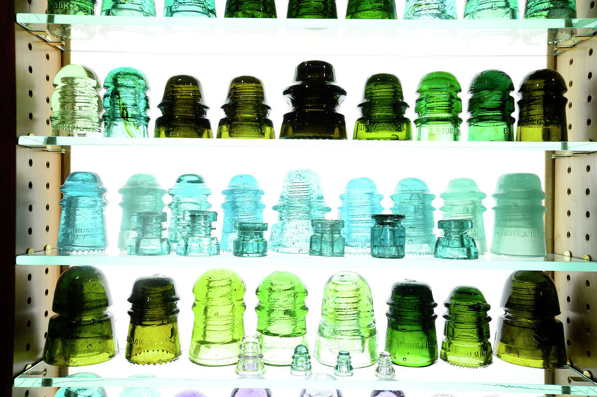 Colorful glass insulators on display in Elton Gish collection of more than 2,000 antique electrical insulators. Gish said he was first attracted to the hobby after seeing a neighbor's small collection of the colorful glass type. Photo taken Friday 6/1/18 Ryan Pelham/The Enterprise