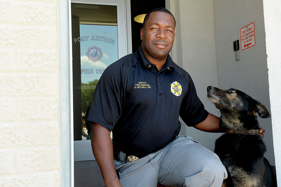 Antonio Mitchell, Depouty Fire Marshall and K-9 handler, poses with Port Arthur Fire Department's bomb detection dog Sarik. The pair are the first responders locally for bomb threat response and suspicious package threats. They recently worked the scenes of the St. Stephen's church bombing and threat at the Jefferson County Courthouse. 
