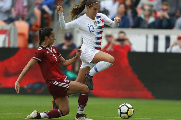 U.S. Women's Soccer forward Alex Morgan (13) dodges a tackle by Mexico National Team defender Bianca Sierra (3) during the first half of the friendly match at BBVA Campus Stadium on Sunday, April 8, 2018, in Houston. ( Yi-Chin Lee / Houston Chronicle )