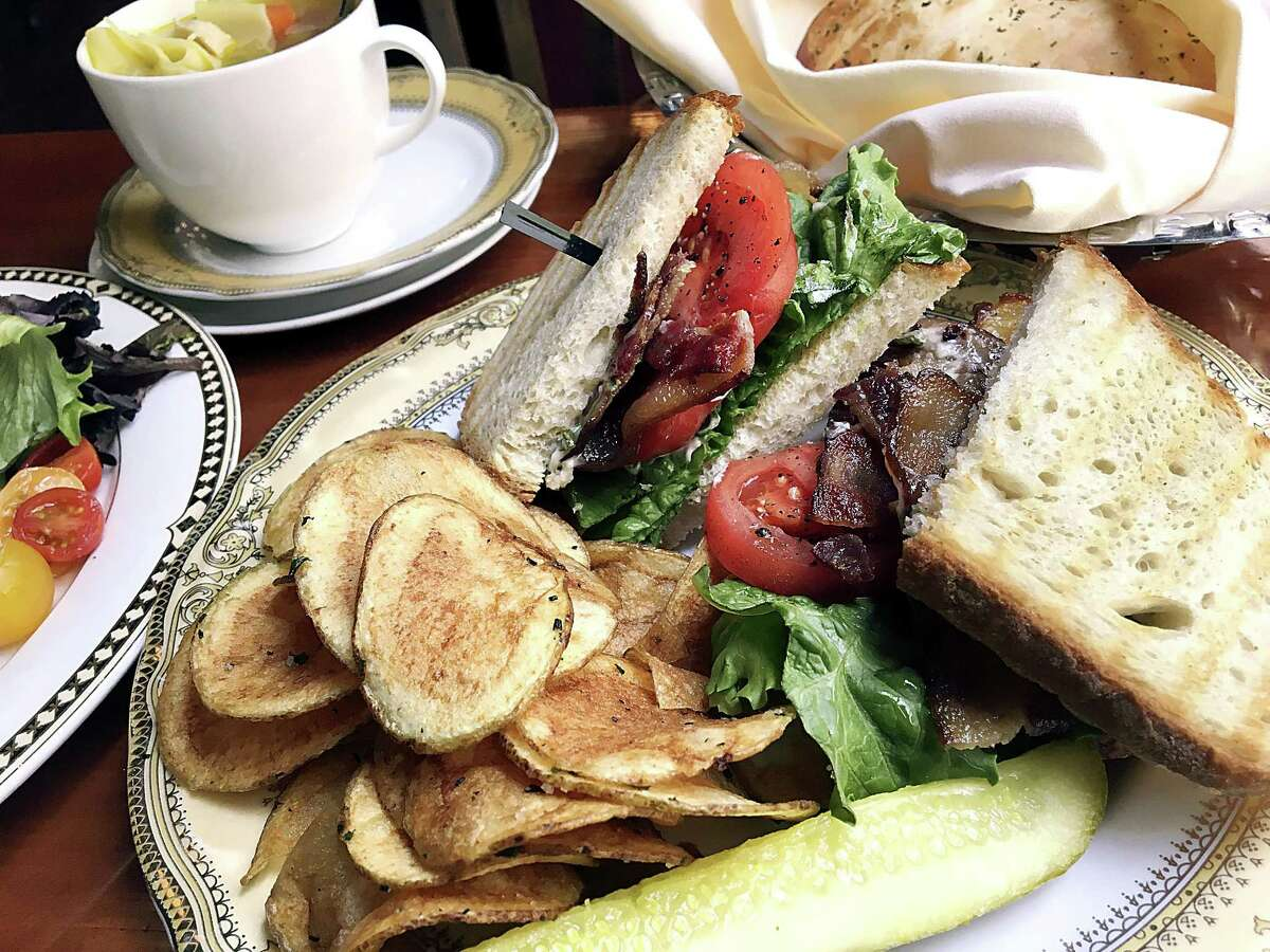 Kurobuta BLT at The Bar at Bohanan's From 11 a.m. to 2 p.m. on the weekdays, the Jazz Age luxury of Bohanan's Prime Steaks and Seafood takes a seat at the bar downstairs, where a BLT with chips is just $10.95. But this is Bohanan's, so you get country club service and gilded china to go with your bacon, lettuce and tomato sandwich. And not just bacon, but sweet and smoky boutique Kurobuta bacon from prized Berkshire hogs, dressed with Romaine, heirloom tomatoes and basil pesto aioli. 219 E. Houston St., 210-472-2202, bohanans.com/bar