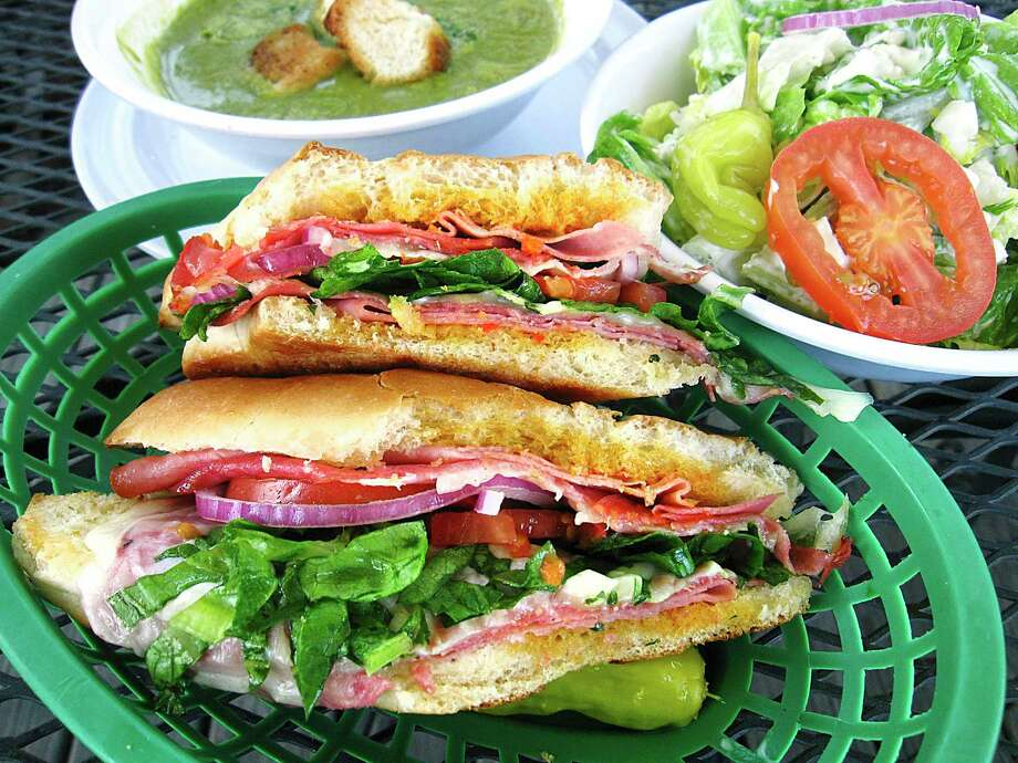 The Dean Martin sandwich with Genoa salami, capocollo, mortadella, provolone, mozzarella and roasted red pepper sauce from Cerroni's Purple Garlic on Austin Highway in San Antonio. Shown with a side salad and spinach garlic soup. Photo: Mike Sutter /Staff
