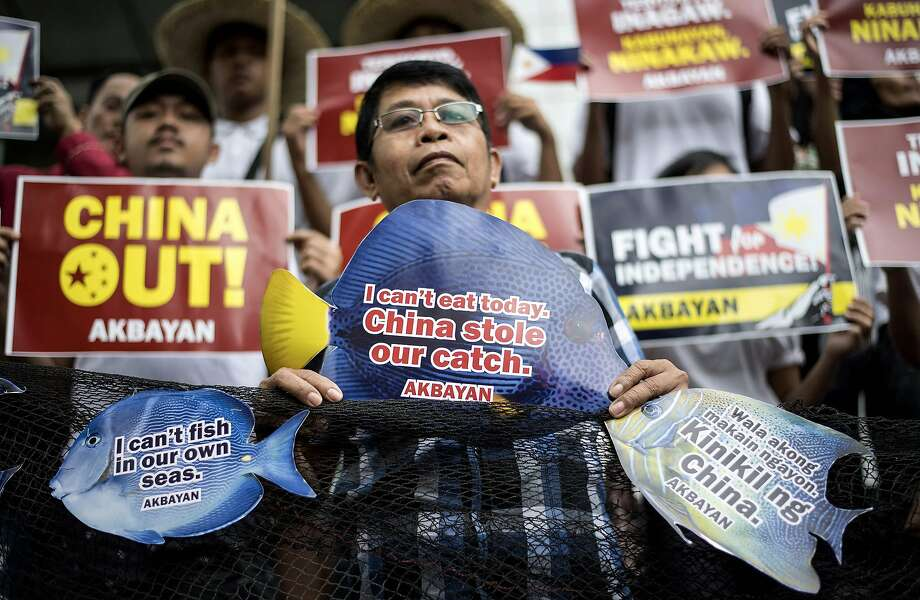 Protesters rally at the Chinese Consulate in Manila. Philippine fishing crews say the Chinese coast guard confiscated their catch in the South China Sea. Photo: Noel Celis / AFP / Getty Images