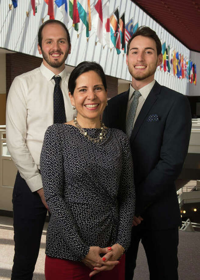 SIUE May 2018 graduates Gabriele Fancelli, left, and Pietro Beimer, of Italy, stand with Silvia Torres-Bowman, director of the International Trade Center at SIUE. Photo:       For The Telegraph