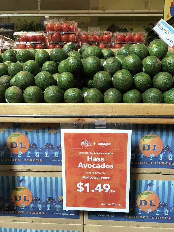 Whole Foods and Amazon logos share equal space on a display in August 2017 at a Whole Foods Market in San Francisco. Photo: Tara Duggan / Tara Duggan / The Chronicle / The San Francisco Chronicle