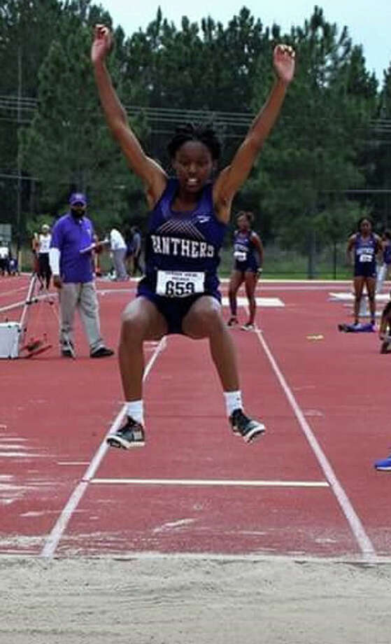 Former Plainview Lady Bulldog and current Prairie View A&M University jumper Kaizha Roberts prepares for her landing while competing in the long jump during a collegiate track & field meet. Roberts was the SWAC outdoor and indoor champion in the triple jump and outdoor champion in the long jump. Photo: Courtesy Of LaTosha Myers