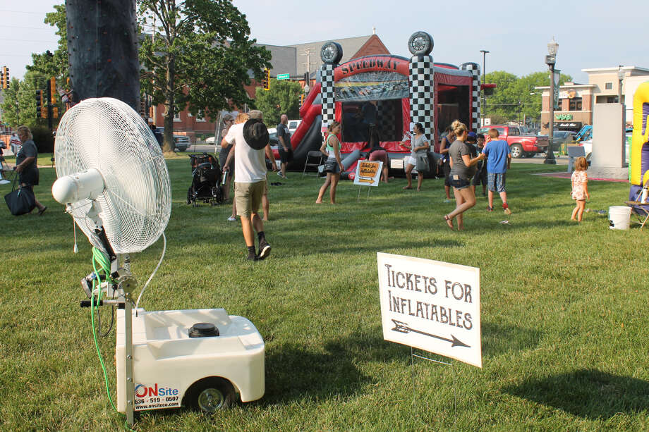 A cooling fan stands at the ready Friday at City Park during the Edwardsville's 21st Route 66 Festival. The two-day event served up live music, historic displays, a car cruise, trolley tours and activities for children.