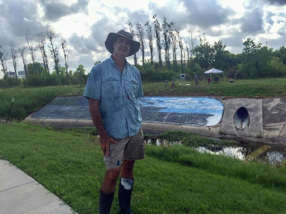 Larry Crawford is in the process of painting a mural along a trail in the Westchase District that will have a Hurricane Harvey theme. Photo: Westchase District