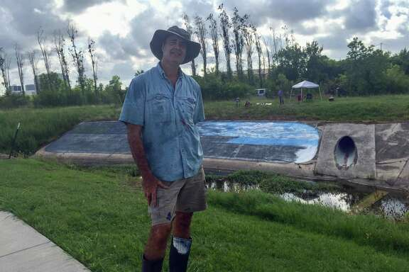 Larry Crawford is in the process of painting a mural along a trail in the Westchase District that will have a Hurricane Harvey theme.