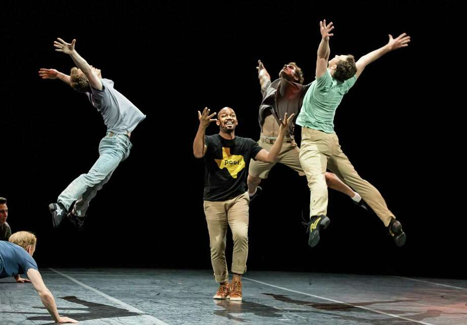 """Houston poet Outspoken Bean, center, with Houston Ballet's Rhodes Elliot, from left, Brian Waldrep and Aaron Daniel Sharratt in Stanton Welch's """"What the H Stands For,"""" one of several new works created to celebrate resilience after Hurricane Harvey. Photo: Amitava Sarkar / Amitava Sarkar / 2017"""