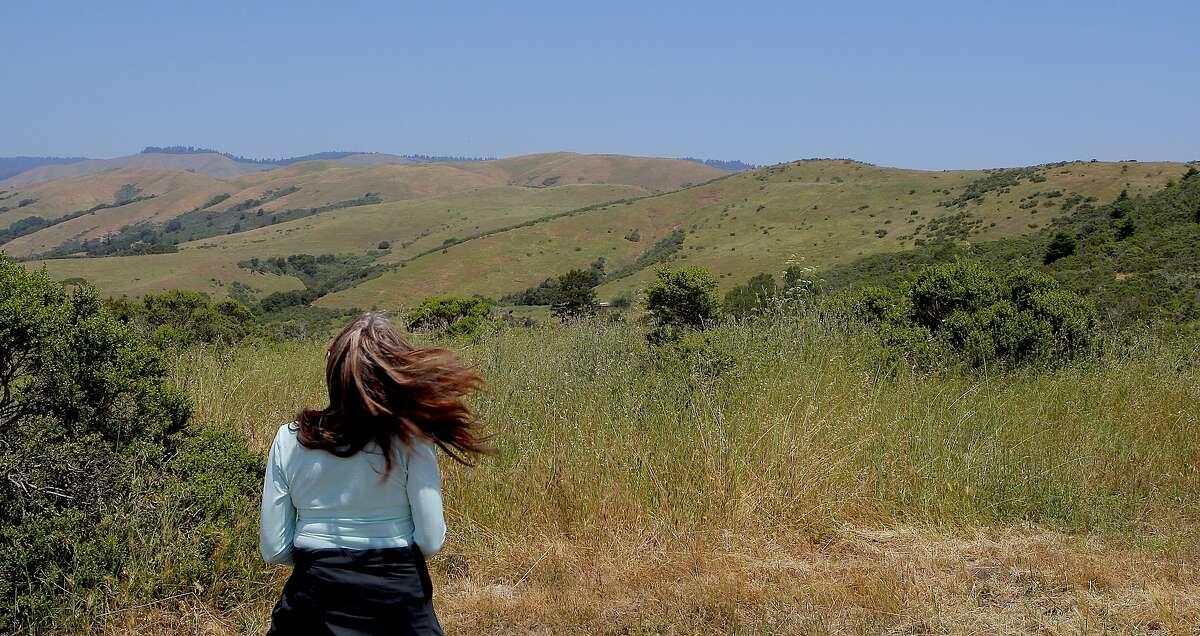 From coastal ridge, Denese Stienstra takes in foothill view across La Honda Creek Open Space Preserve