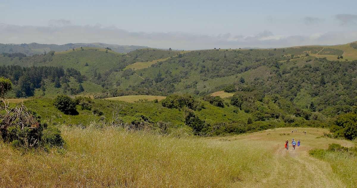 Hikers descend toward coast in La Honda Creek Open Space Preserve