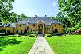 The red brick colonial house at 45 Aspetuck Falls is located on a private cul-de-sac in the Greenfield Hill neighborhood.