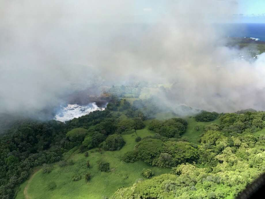 Heated by lava, Hawaii's Green Lake evaporates away on Saturday, June 2. It took less than two hours for the 200-foot-deep lake to disappear. Photo: Hawaii County Fire Department/U.S. Geological Survey