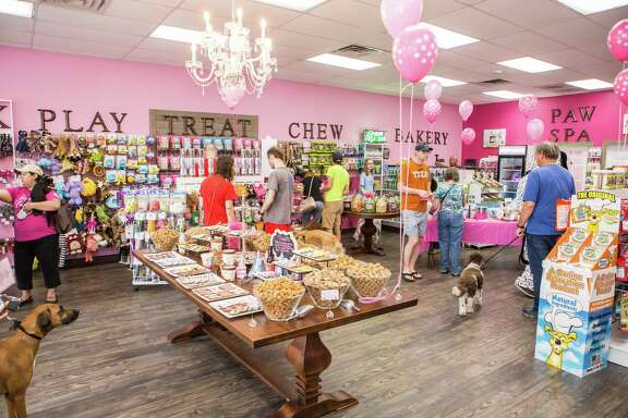 Woof Gang Bakery & Grooming, owned by Erin and Markos Hernandez, had its grand opening on May 19. The store is located at 3135 W. Holcombe Blvd.