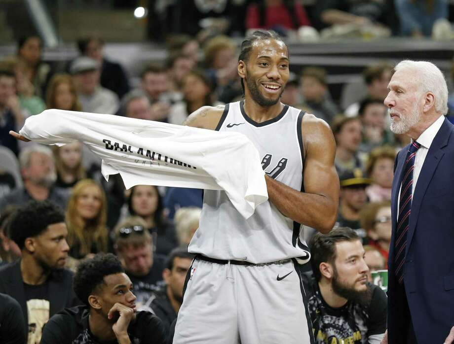 San Antonio Spurs' Kawhi Leonard jokes with head coach Gregg Popovich on the bench during first half action against the Denver Nuggets Saturday Jan. 13, 2018 at the AT&T Center. Photo: Edward A. Ornelas, Staff / San Antonio Express-News / © 2018 San Antonio Express-News