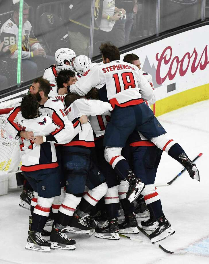 LAS VEGAS, NV - JUNE 07: Chandler Stephenson, No. 18, of the Washington Capitals leaps into his teammates' arms, as they celebrate their 4-3 win over the Vegas Golden Knights in Game 5 of the 2018 NHL Stanley Cup Final, at T-Mobile Arena, on June 7, 2018, in Las Vegas, Nevada. Photo: Ethan Miller / Getty Images / 2018 Getty Images