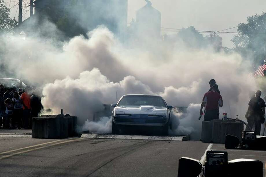 Vehicles burn rubber during the Rod Benders Street Association 2018 Night of Thunder and Car Show Friday, June 8 in Coleman. (Photo provided/Steve Henderson) Photo: Photo Provided/Steve Henderson