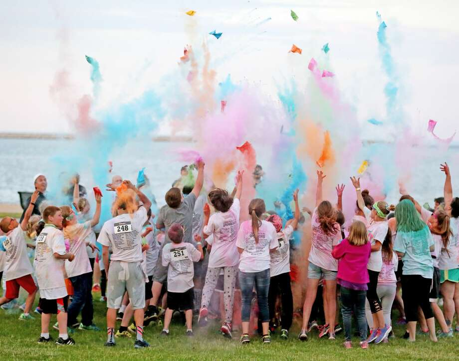 "It was a colorful evening, Friday, at Harbor Beach's Lincoln Park. Children of all ages participated in the Colorpalooza Family Fun Run, hosted by Zion Lutheran School. Runners made their way through a course filled with obstacles and four ""color stations"" where they were bombarded with the cornstarch based powder. Following two races, there was a final color toss near the center of the park. Photo: Paul P. Adams/Huron Daily Tribune"