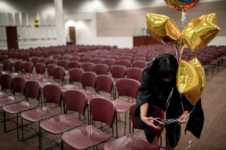 Middle College Principal Diana Del Pilar stays behind to tidy up from graduation, after all the students and families have left. Photo: Jon Shapley / © 2018 Houston Chronicle
