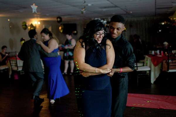 Diana Del Pilar teaches her former student, Carrington Green, how to dance at prom.