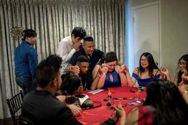 "Thank God for giving us a prom. And thank God for,"" Carmen Zuniga begins. Her friends all join in to finish the prayer, yelling ""GRADUATION!"" all at once."