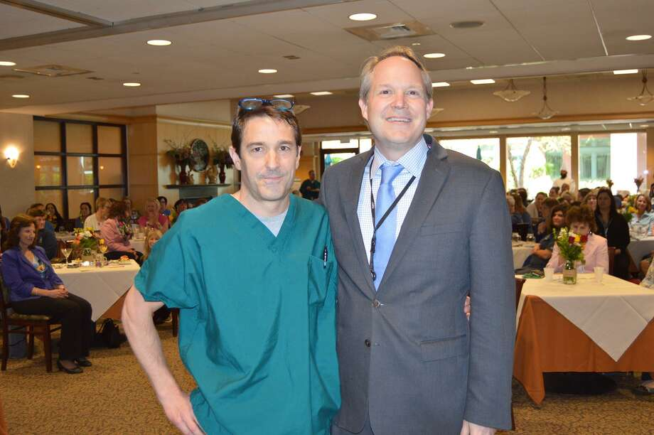Podiatrist Luke Jeffries, DPM, left,  received the Physician of the Year Award from Griffin Hospital Chief  Medical Officer, Frederick Browne, MD, at Griffin Hospital's 32nd Annual  Nurses Week luncheon. Photo: Contributed / Griffin Hospital