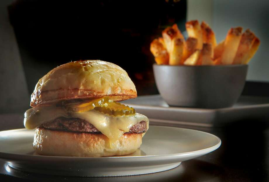 Burger with a side of fries at Prospect in S.F. Photo: John Storey / Special To The Chronicle
