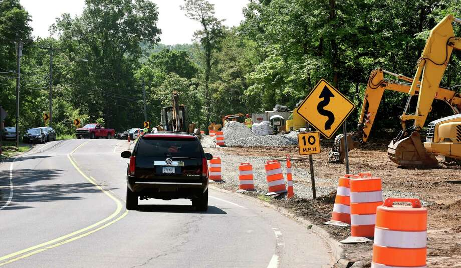 An SUV drives toward the Snake Hill section of Brushy Plain Road in Branford which is being realigned. Photo: Arnold Gold / Hearst Connecticut Media / New Haven Register