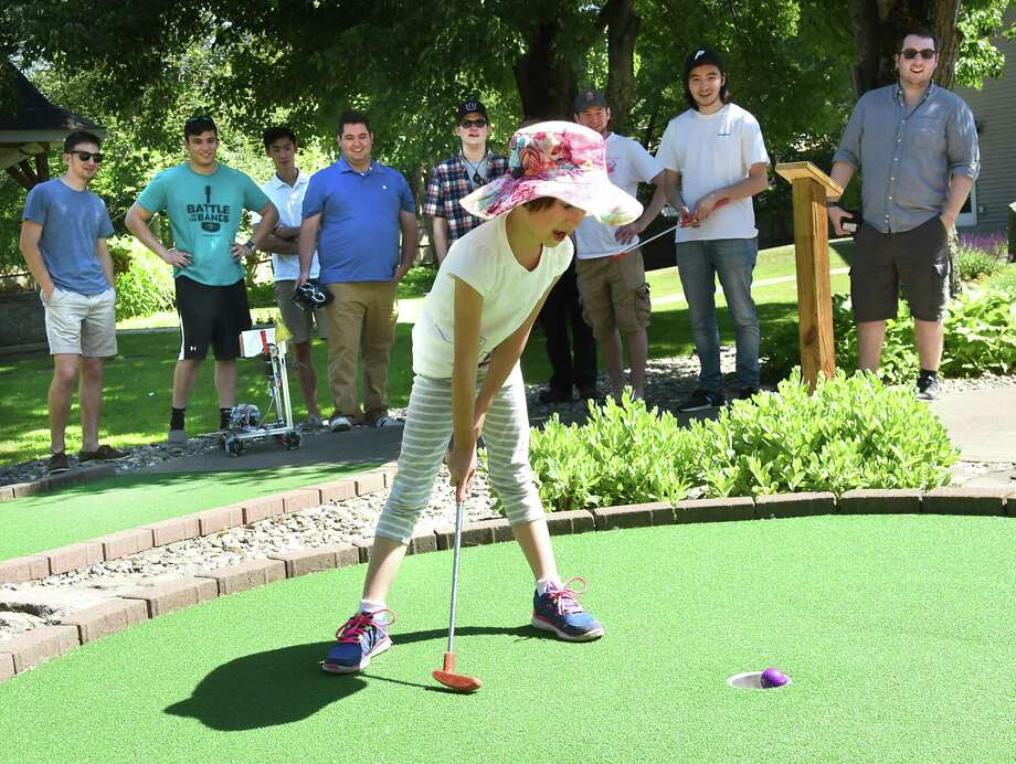 Gracie Keat, age 6, makes a putt as she plays miniature golf at Pirate's Cove on Monday, June 11, 2018 in Waterford, N.Y. She was competing against robots controlled and made by Union College students. The students are in her father Professor Bill Keat's mechanical design class. (Lori Van Buren/Times Union) Photo: Lori Van Buren, Albany Times Union / 40044042A