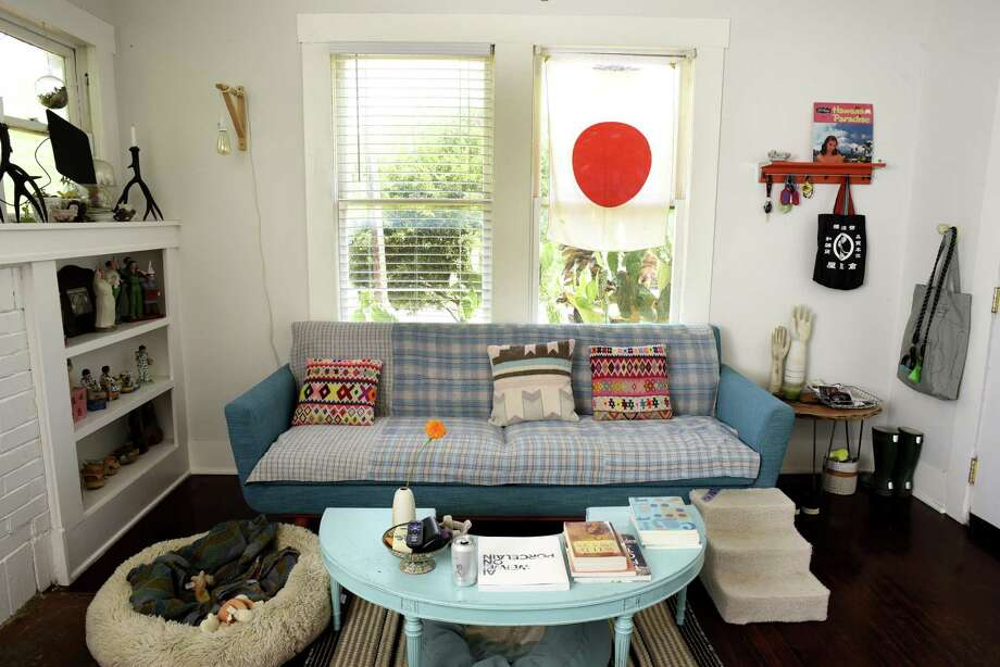 The living room in the home of ceramic artists Jennifer Datchuk and Ryan Takaba. Photo: Billy Calzada /San Antonio Express-News