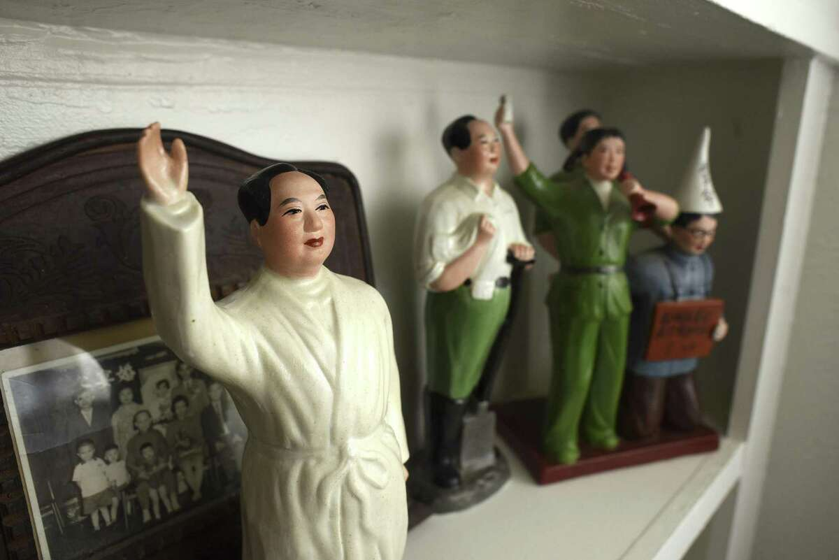 Ceramic artists Jennifer Datchuk and Ryan Takaba have a collection of Chairman Mao pieces, acquired from trips to China, in their living room.