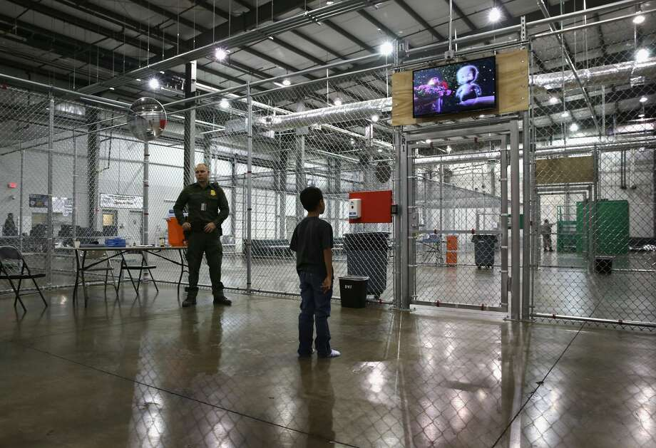 A boy from Honduras watches a movie at a detention facility run by the U.S. Border Patrol on September 8, 2014 in McAllen, Texas.