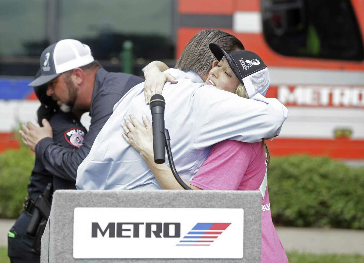 Tom Lambert, Metro CEO and president, left, is hugged by Wendy Mills, right, as her husband, David Mills, back right, hugs Metro Police Chief Vera Bumpers, back left, after a press conference Monday, June 11, 2018, in Houston about METRO partnering with the Kailee Mills Foundation to raise awareness about the importance of safe teen driving and seat belt usage. David Mills and Wendy Mills formed the Kailee Mills Foundation following the death of their daughter, Kailee Marie Mills, 16, who died on October 28, 2017 in a car accident due to not wearing her seat belt. The non-profit foundation seeks to educate young and old alike on the value of safe driving and seat belt use. ( Melissa Phillip / Houston Chronicle )
