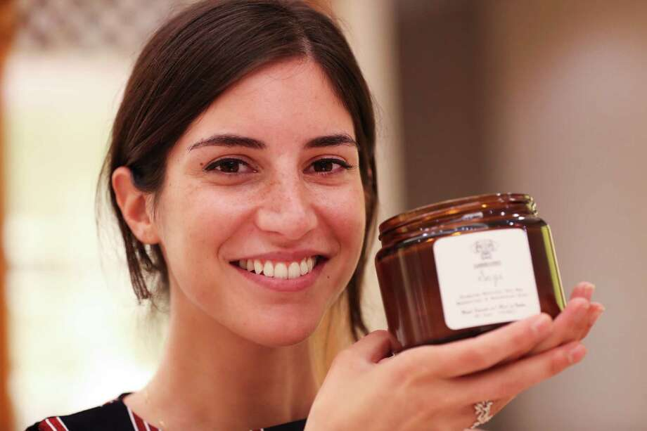 Garden State Candles founder Maya Sriqui led a workshop on how to make fragrant, soy-based candles at Neiman Marcus. Photo: Steve Gonzales, Houston Chronicle / Houston Chronicle / © 2018 Houston Chronicle